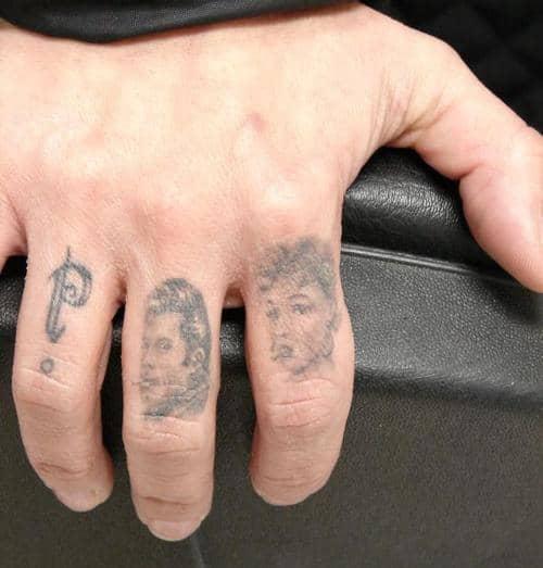 faded finger tattoos