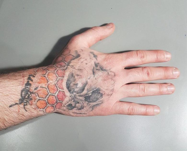 Faded Hand Tattoo